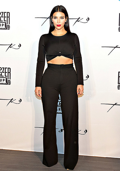 kiK Kardashian Displays Toned Abs in a Crop Top High Waisted Pants