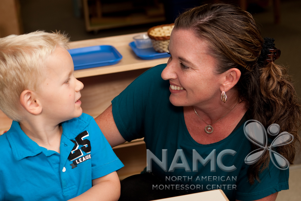 NAMC Montessori Twenty Years teacher and child smiling