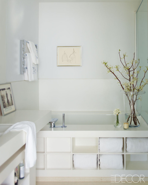 built in tub and shower. I like the clean lines  creamy white and sleek faucets love simple shower handle with To da loos Tub base Tuesday Chic built in tub shelving