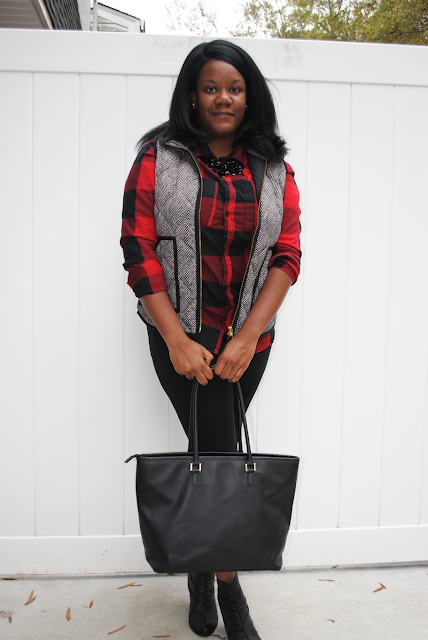 A holiday outfit inspiration post featuring a buffalo plaid shirt, herringbone vest, black pants and black booties.
