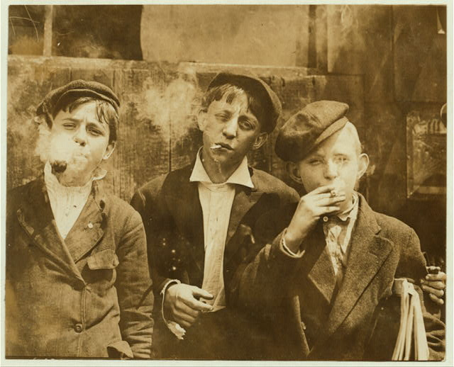 "40 Amazing Historical Pictures - ""11:00 A. M . Monday, May 9th, 1910. Newsies at Skeeter's Branch, Jefferson near Franklin. They were all smoking. Location: St. Louis, Missouri."