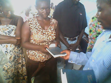 SISTER MARIA OF MALABA RECIEVING A BIBLE..TOO