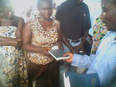 SISTER MARIA OF MALABA RECIEVING A BIBLE..TOO