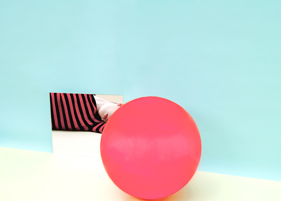 Red ball and woman in stripe shirt