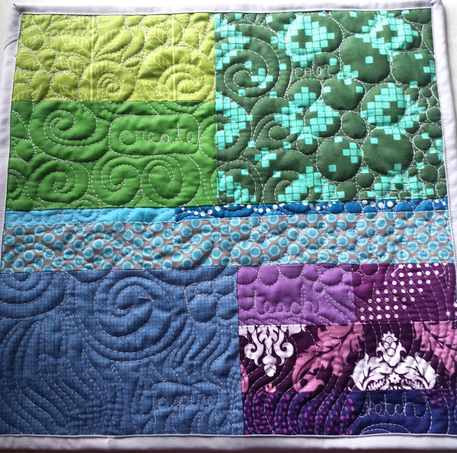 http://quiltyhabit.blogspot.com/2015/06/palette-mini-quilt.html