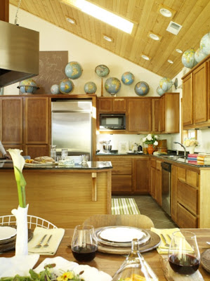 mylittlehousedesign.com globes on top of wooden kitchen cabinets