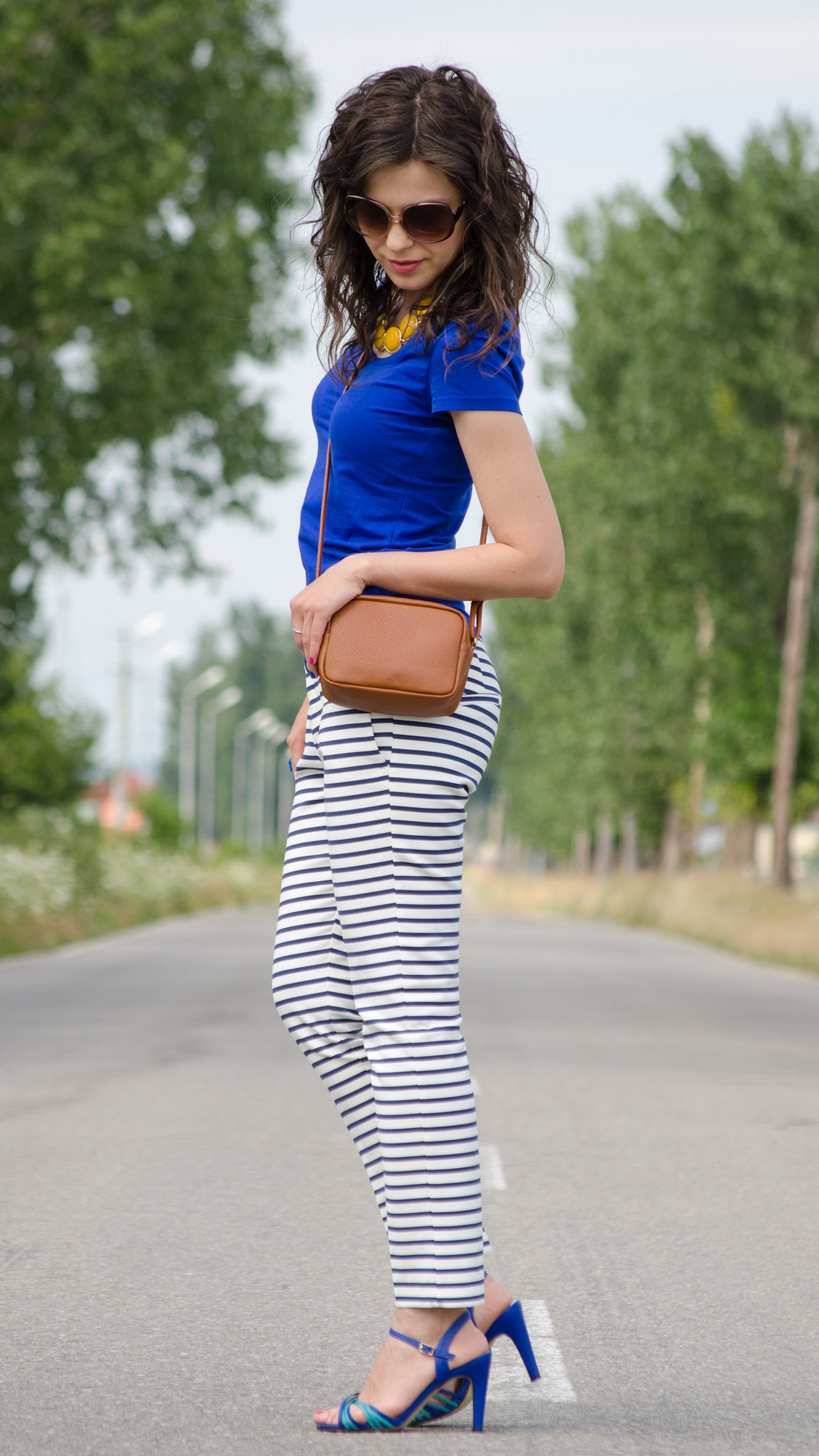 zara navy stripes pants H&M blue t-shirt brown satchel mustard statement necklace poema
