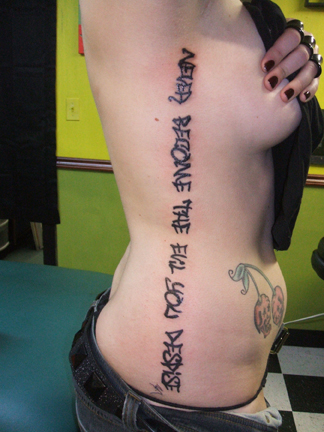 tattoos for women on ribs. Rib Tattoos For Girls 2011