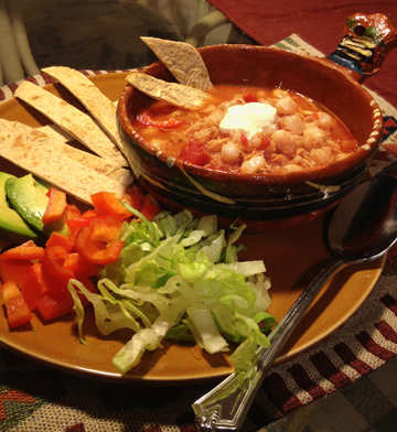 Chicken Posole with topping ideas on the side. Lettuce, Avocado, red bell peppers