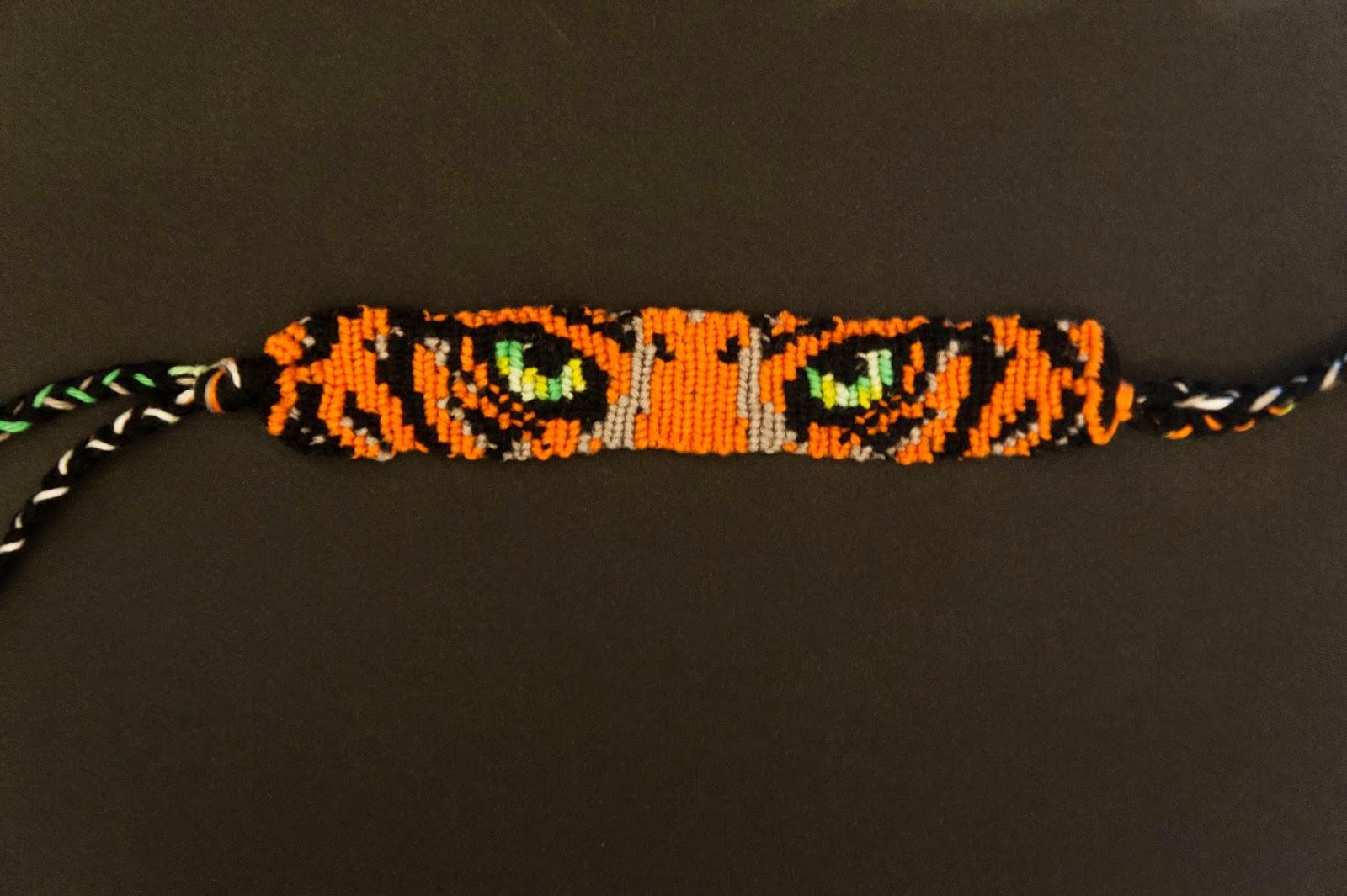 Bracelet tigre bracelets br siliens - Comment faire les bracelet elastique ...