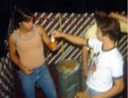 1976/1977 Joey on the right handing me a Miller nip beer later that night at Ronnies 17th B-Day party