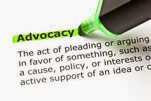 The word Advocacy on a page being highlighted by a green highlighter pen