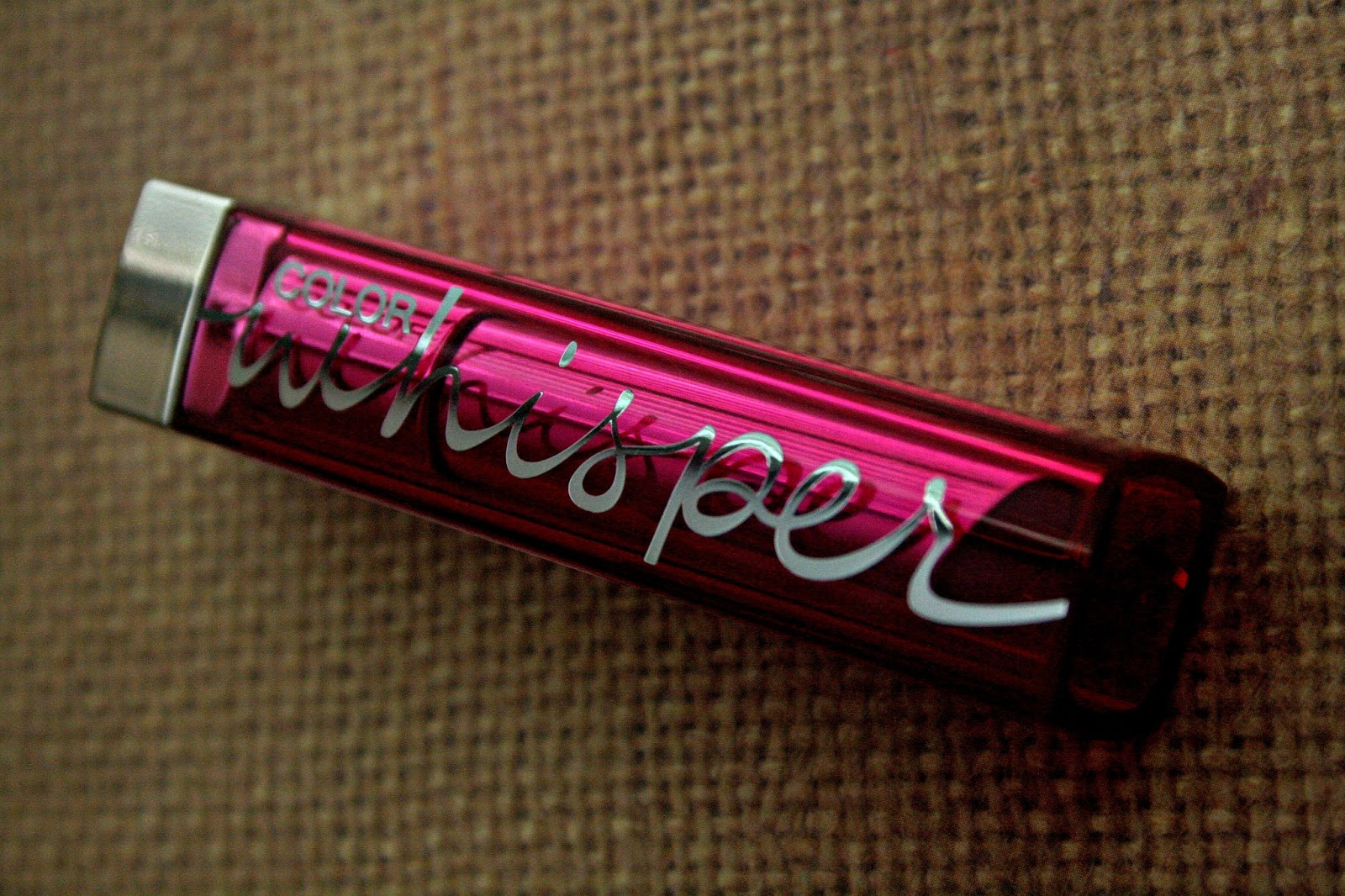 Maybelline Color Whisper Lipstick in Mad For Magenta Packaging