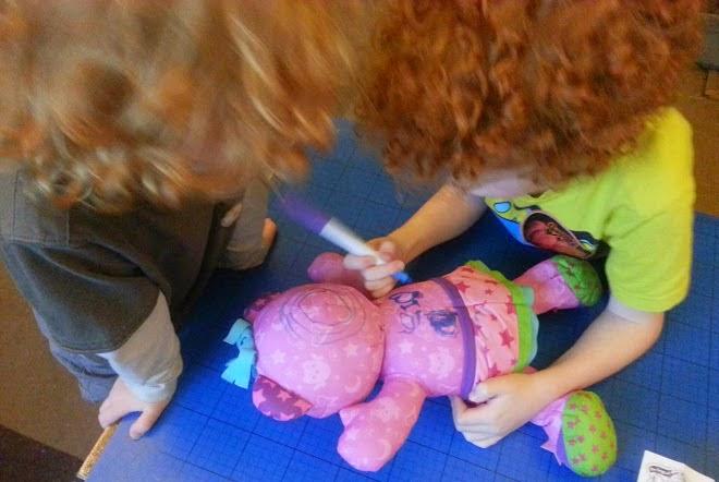 Boys coloiuring a Doodle Bear