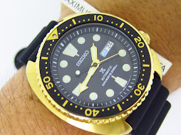 SEIKO TURTLE PROSPEX AUTOMATIC DIVE WATCH WITH GOLDTONE CASE AND BLACK SEIKO DIVE STRAP - SRPC44