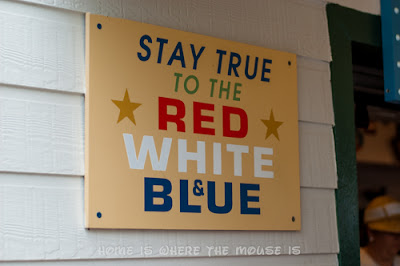 """A Sign at Rosie's All-American Cafe in Disney's Hollywood Studios reminds us to """"Stay True to the Red, White, and Blue"""""""