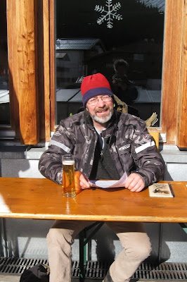 A cheery Mr A with a beer in the sunshine