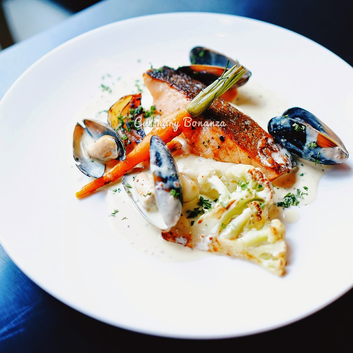 Norwegian Salmon - pan seared, served with blue shell mussels, cream sauce & mash potato