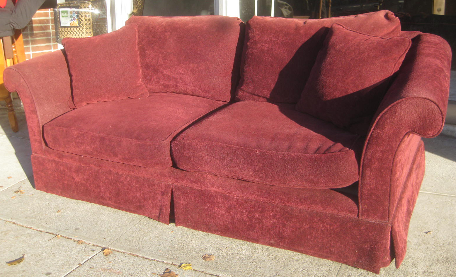UHURU FURNITURE & COLLECTIBLES SOLD Burgundy Sofa $50