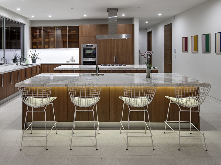 Kitchen and chairs in Sunset Plaza Drive modern mansion in Los Angeles