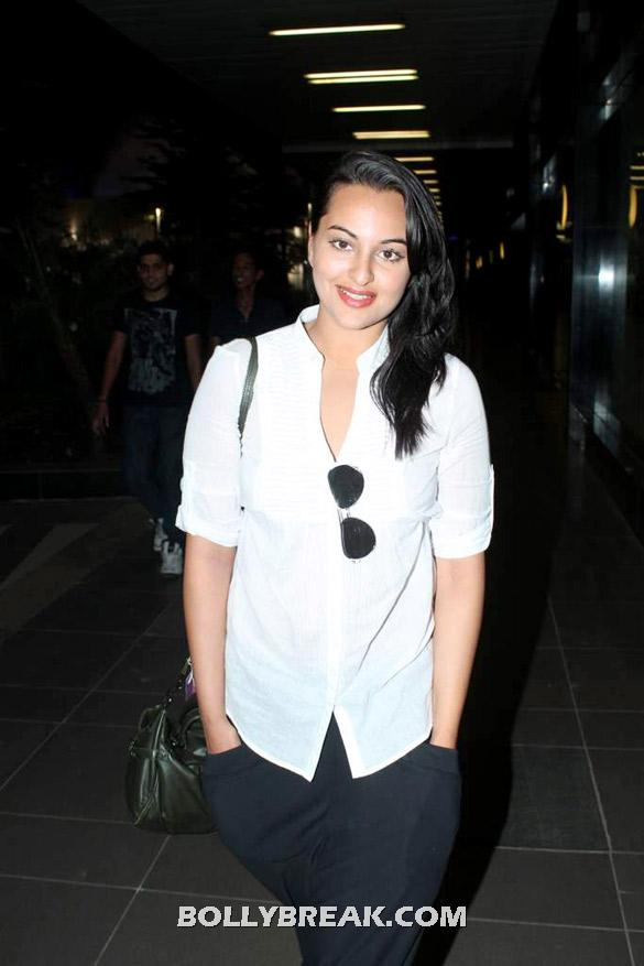 Sonakshi Sinha in white shirt black pants -  Sonakshi Sinha snapped at the airport