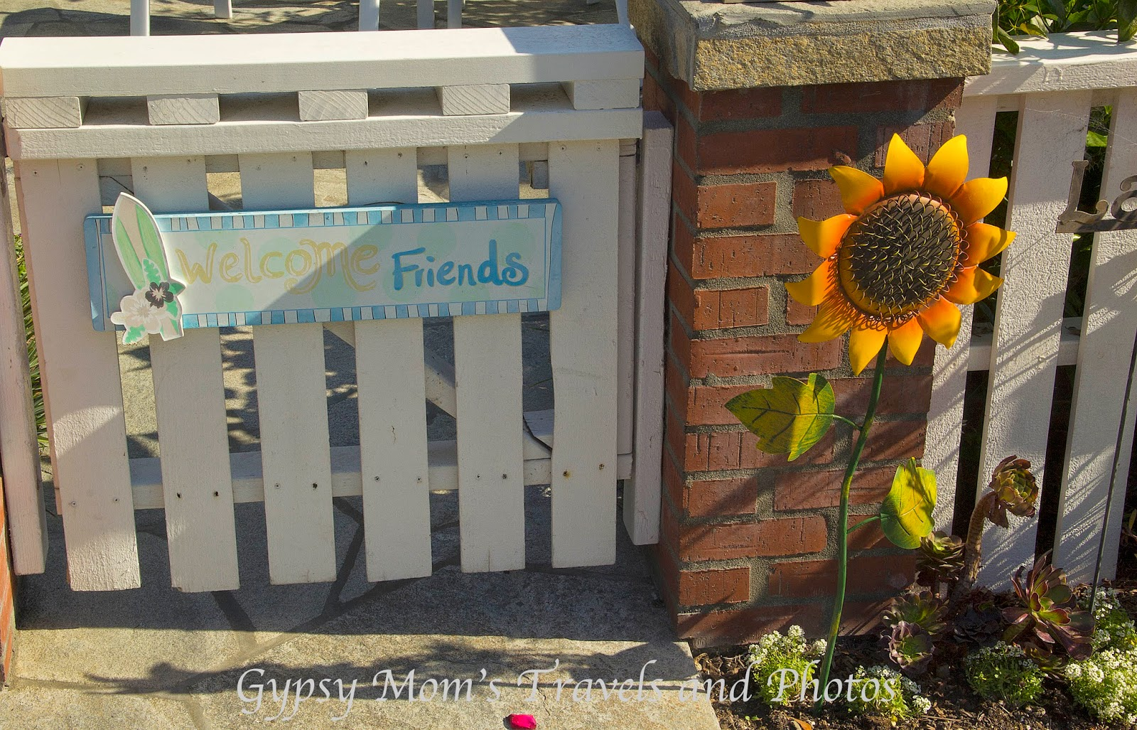 Sunflower and Welcome friends on gate on house in Corona del Mar