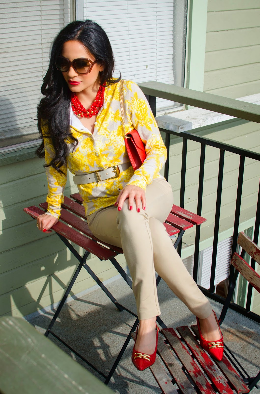 red and yellow sweater Gucci sunglasses and Christian Dior purse