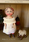 litho doll, sheep pulltoy on Ebay