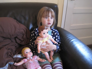 Little girl and two dolls