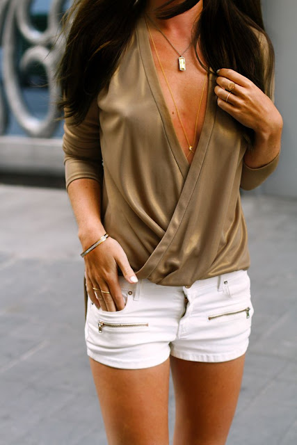 Golden sweater and white mini skirts for ladies street style