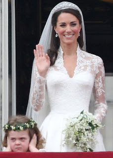 Designers praise Kate's classic wedding gown