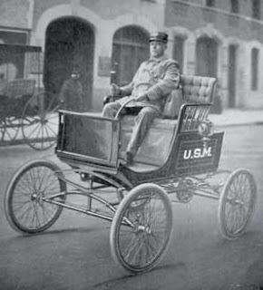 A horseless carriage used to deliver the US mail.
