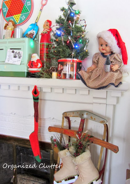 Vintage Toys Christmas Mantel www.organizedclutterqueen.blogspot.com