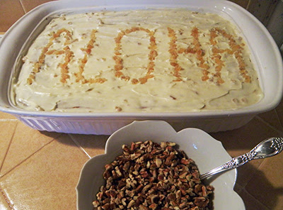 Cake with Aloha written on it in ginger
