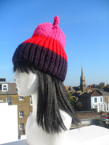 NEW IN .WRAP UP WARM IN STRIKING STRIPES PEAR HAND-KNIT HAT .*BY FLORA LYIMO DESIGNER*