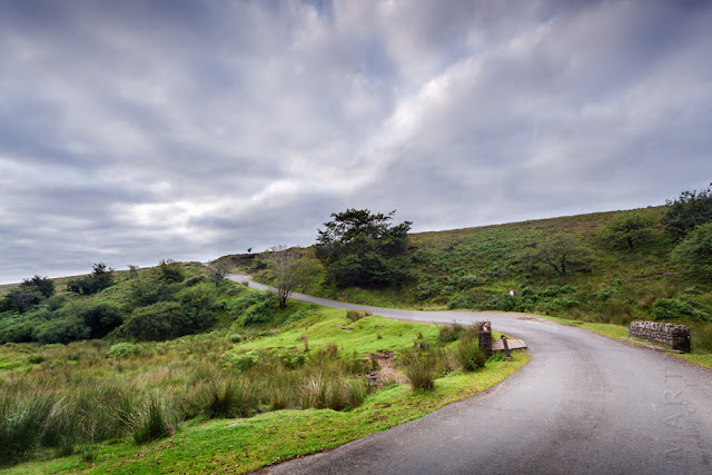 A small lane winds over the Exmoor landscape under cloud by Martyn Ferry Photography