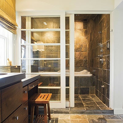 bathroom with sliding shower doors