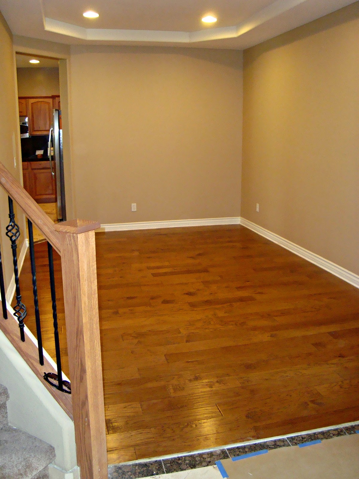 Formal Dining Room. Notice the banister. We had to pick a wood that  title=