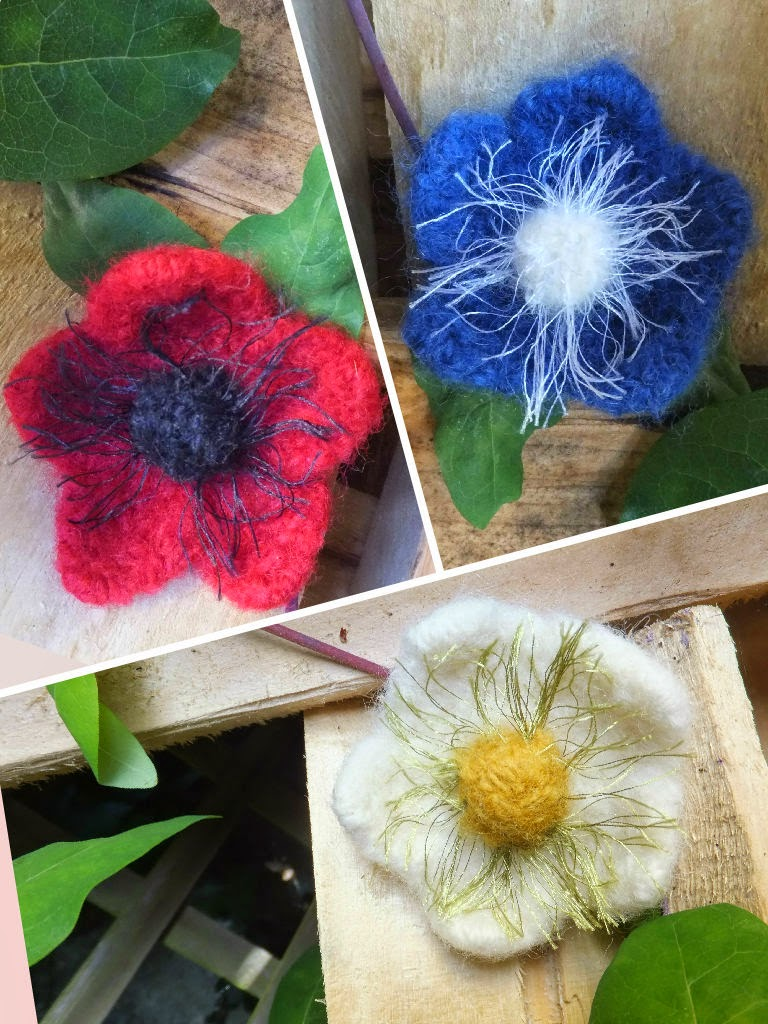 felted flowers in red, cream and blue