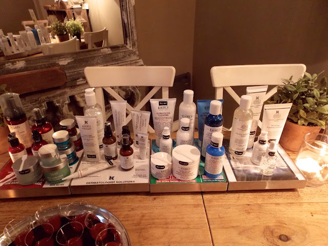 A picture of Kiehl's skincare on a wooden table