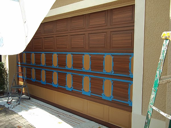 You can paint your garage door to look like wood for Wood looking garage doors