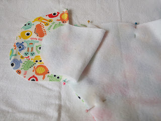 Handmade by Joanne Rich. Pinning the Velco tab covers to the cloth diaper
