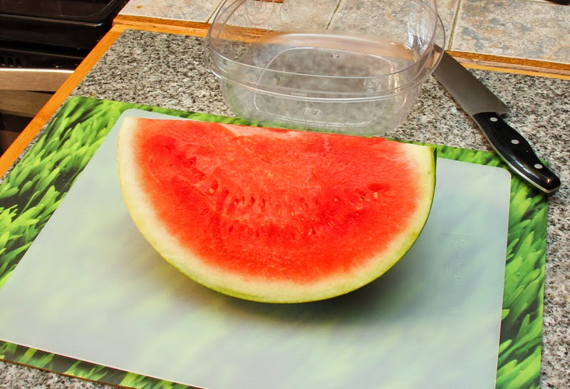 Slice watermelon into quarters