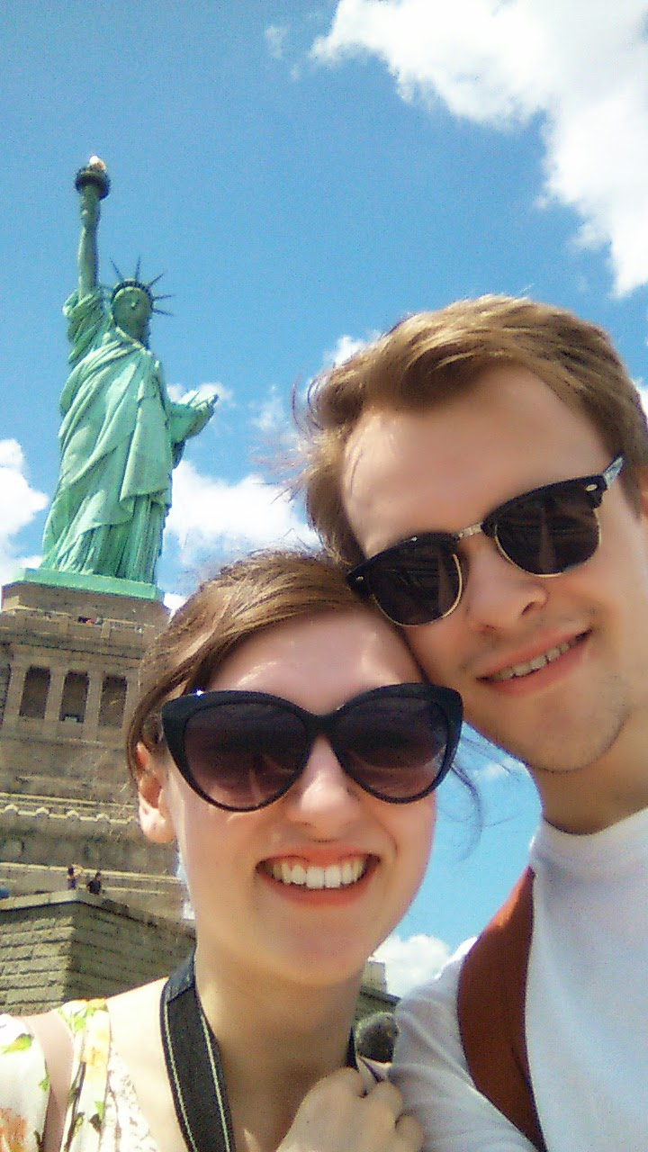new york city statue of liberty clear day beautiful sun selfie