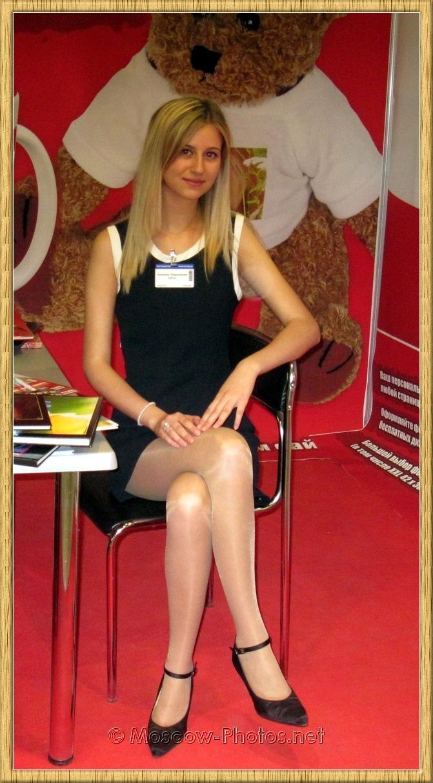 Crossed Legs Smiling Blonde Moscow Model