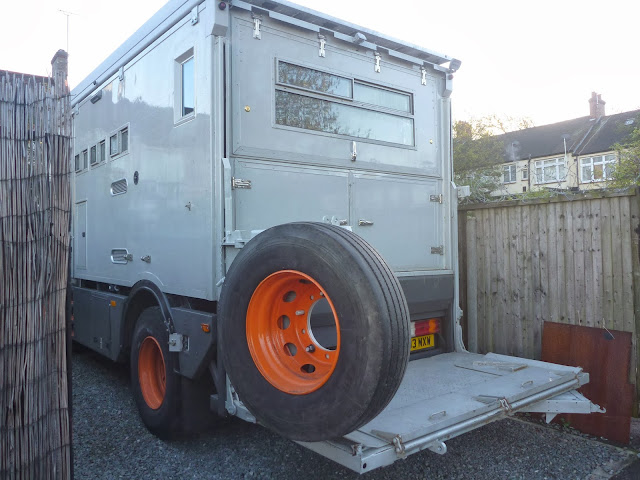 Swing out wheel carrier, allows acces to tail lift platform and rear storage