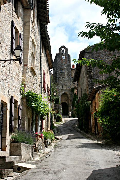 clock tower at top of steep narrow road
