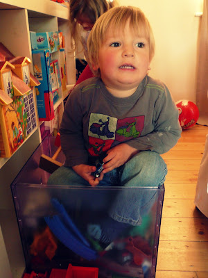 wee one in a toy box