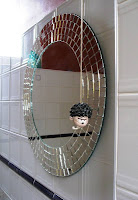 Round mirror with Dennis the Menace pull cord
