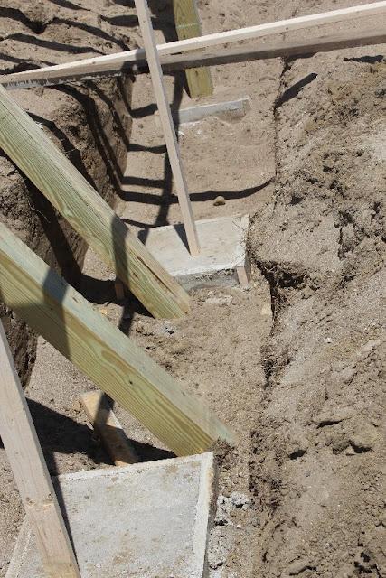 Below grade footings for a deck